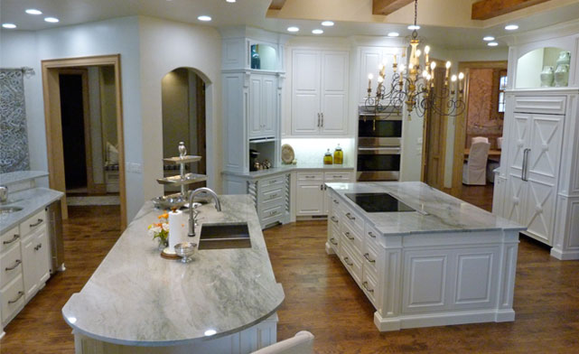 Large kitchen with beams and three islands from Majestic Construction remodel