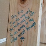 Bible verse written on wall stud during home renovations by Majestic Construction
