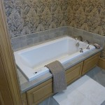 Large soaker tub with built in storage from Majestic Construction bathroom renovation