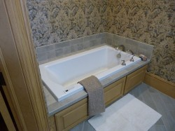 Bathroom remodeled with luxurious bathtub designed by Majestic Construction