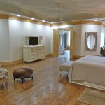Spacious master bedroom with tray ceilings designed by Majestic Construction