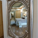 Large antique mirror in newly remodel bedroom from Majestic Construction