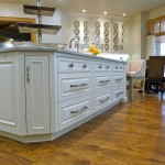 Large kitchen island with corner cabinet to maximize space from Majestic Construction reno