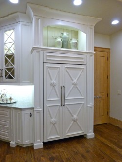 Overlay refridgerator in remodeled kitchen by Majestic Construction