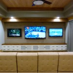 Theater room with built in media cabinet from Majestic Construction